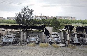 Burnt cars after heavy fighting in Luhansk on June 3