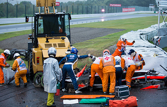Course marshalls and doctors at French Formula One driver Jules Bianchi of Marussia F1 Team crash site