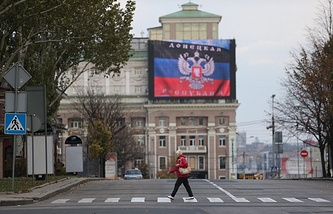 Flag of the self-proclaimed Donetsk People's Republic seen on a building in Donetsk