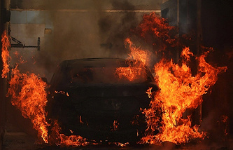 Car on fire, Libya (archive)