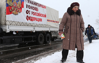 Trucks of a Russian convoy carrying humanitarian aid for eastern Ukraine residents