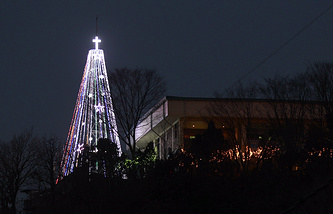 Steel Christmas tree lit up at the western mountain peak known as Aegibong in Gimpo, South Korea (Archive)