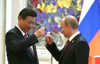 Chinese President Xi Jinping and Vladimir Putin after signing cooperation agreements