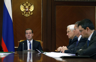 Russian Prime Minister Dmitry Medvedev at cabinet meeting on Russia's 2015 social and economic development