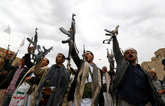 Houthi members during a rally protesting Saudi-led airstrikes against Houthi positions in Sanaa