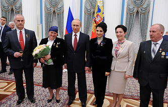 "Vladimir Putin with the holders of the honorary title ""Hero of Labour of the Russian Federation"""