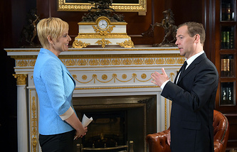 Russian Prime Minister Dmitry Medvedev talking to RTV Slovenija journalist