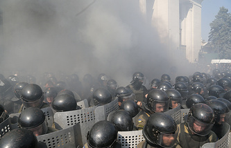 Riot police clashing with protestors in front of the Parliament in Kiev