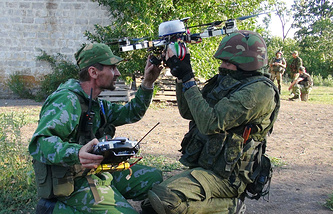 East Ukraine militia fighters while launching a drone
