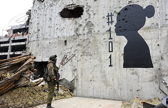 Silhouette of a child with an inscription # 101 (the number of children killed in the conflict in Donbass), on the wall in Donetsk airport
