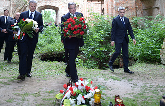Polish President Bronislaw Komorowski and Deputy Speaker of the Polish Parliament Cezary Grabarczyk with flowers in Kiselin, Ukraine to pay homage to the Poles murdered, in the 70th anniversary of the Volhynia tragedy, 2013