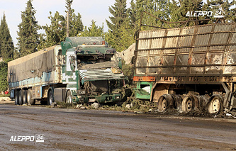 Damaged trucks carrying aid, in Aleppo, Syria