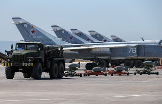Russian fighter jets and bombers at Hemeimeem air base in Syria