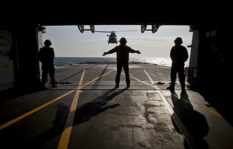 Helicopter landing on the deck of NATO warship during maneuvers in the Black Sea