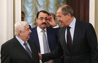 Syria's Foreign Minister Walid Muallem and Russian Foreign Minister Sergei Lavrov