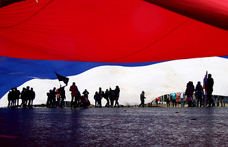 A huge Russian national flag seen during a march marking Russia's National Unity Day in Moscow