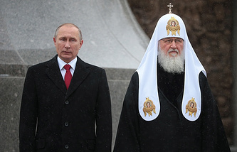 Russia's President Vladimir Putin and Patriarch of Moscow and All Russia Kirill