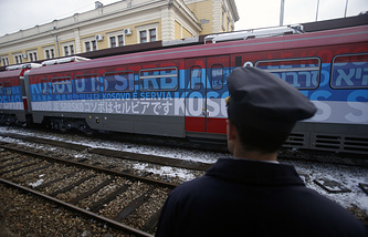 Train decorated with letters reading 'Kosovo is Serbian' written in twenty languages departing from the Belgrade to Mitrovica, Kosovo