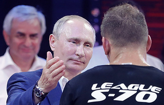 Russian President Vladimir Putin and Vyacheslav Vasilevsky, one of the winners of the Plotforma S-70 sambo wrestling tournament in Sochi