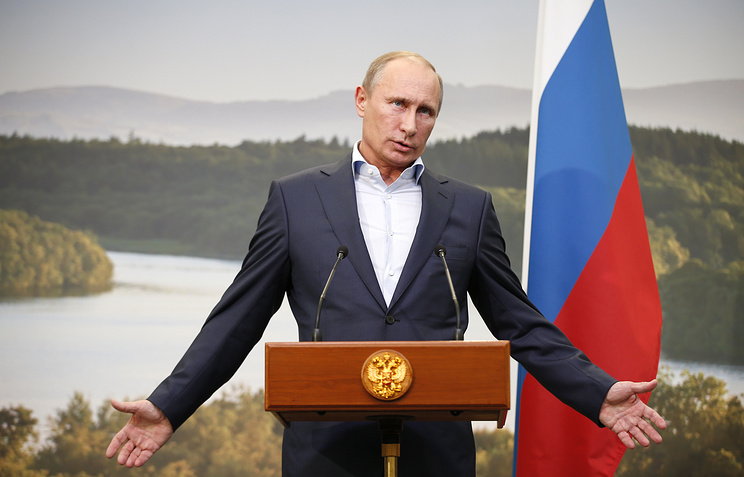 Russian President Vladimir Putin gestures while speaking during a media conference after a G-8 summit at the Lough Erne golf resort in Enniskillen, Northern Ireland