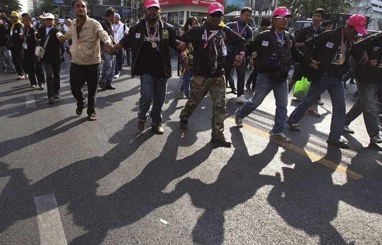 Anti-government protesters march in Bangkok