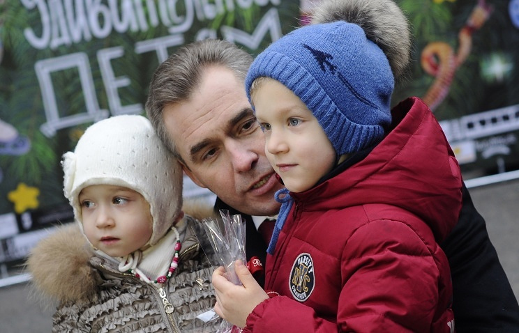 Children's rights ombudsman Pavel Astakhov with orphans