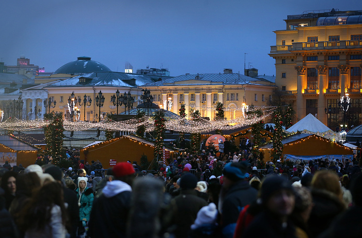 Customers at a Christmas market in Moscow's Manezh Square