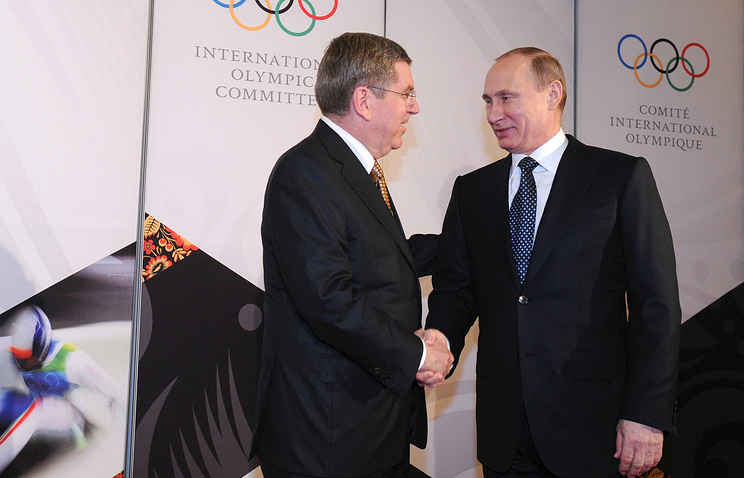 International Olympic Committee (IOC) President Thomas Bach and Russian President Vladimir Putin
