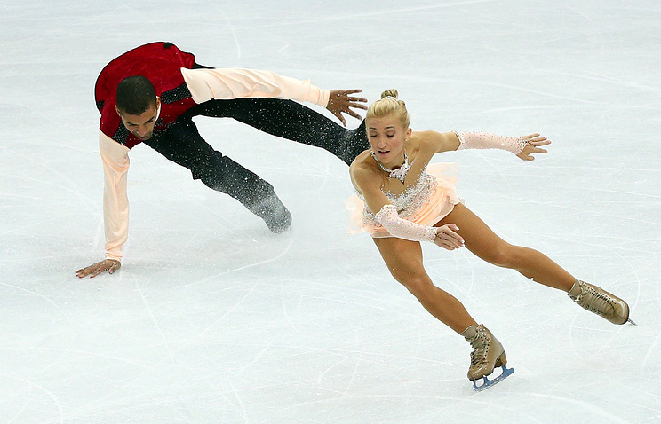 Robin Szolkowy (L) of Germany falls while competing with Aliona Savchenko during the Pairs Free Skating