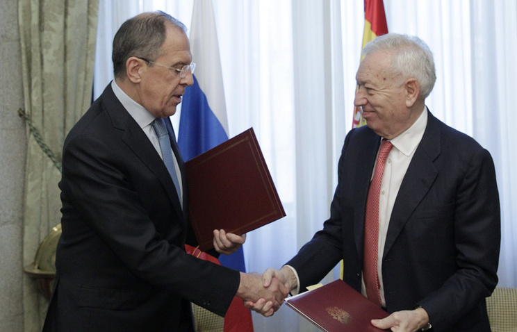 Russia's Foreign Minister Sergei Lavrov and Spain's Foreign Minister Jose Manuel Garcia-Margallo