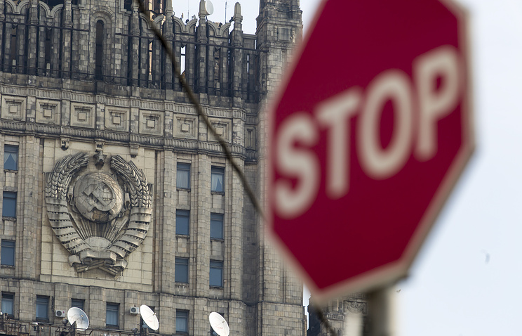 A traffic sign seen in front of Russian Foreign Ministry building (background) in Moscow