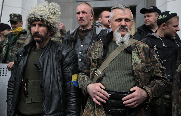 Self defense volunteers line up outside the Parliament in Kiev