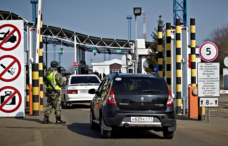 Ukrainian border guard checks vehicles