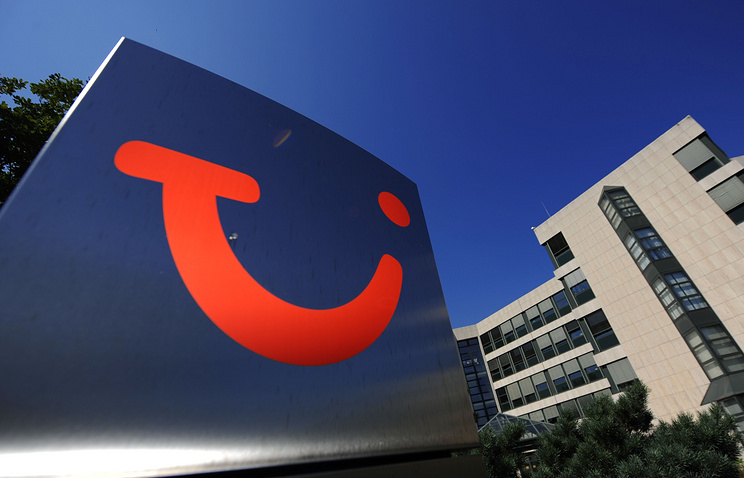 Tui logo in front of the headquarters of Tui tour operators in Hanover