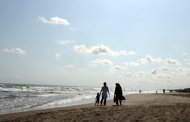 Iranian people on a beach in the city of Anzali , in the Caspian Sea province of Gilan, northern Iran