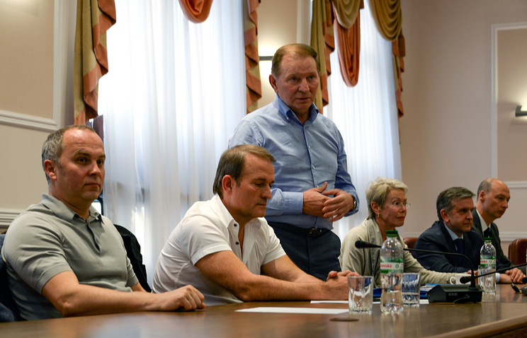 Representatives of Ukrainian government Nestor Shufrich (L), Viktor Medvedchuk (2-L) and Leonid Kuchma (C), during meeting with leaders of Donetsk and Luhansk peoples republic in Donetsk, Ukraine 23 June 2014