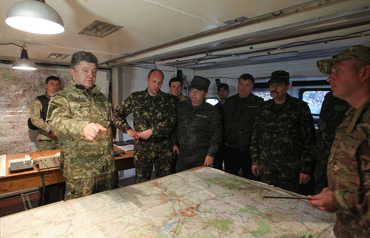 Ukrainian president Petro Poroshenko (left) at the center of the military operation in Ukraine's south-east