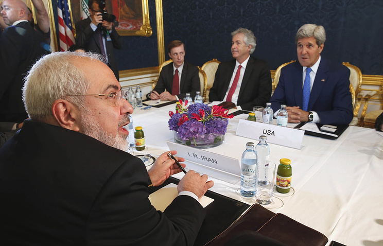 Iran's Foreign Minister Javad Zarif, foreground, holds a meeting with US Secretary of State John Kerry