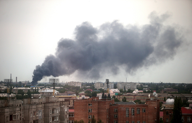 Smoke rises after an airstrike on Luhansk