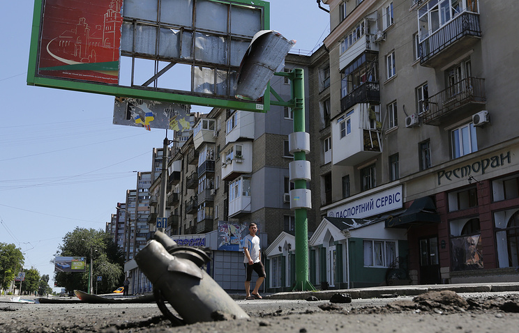 A shell seen in a city street in Luhansk