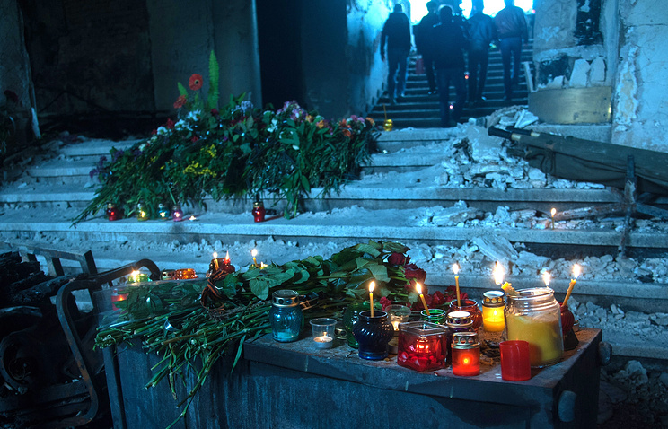 Candles seen inside the House of Trade Unions in Odessa where scores of demonstrators died after the building was set on fire