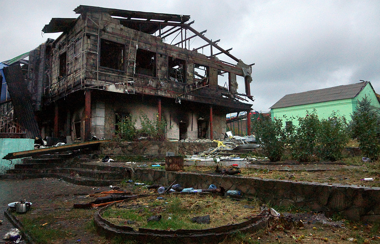 Ruined building on the site of a mine near Donetsk where mass graves were discovered