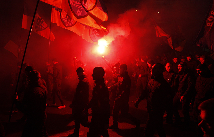 Right Sector nationalist group activists march through Kiev