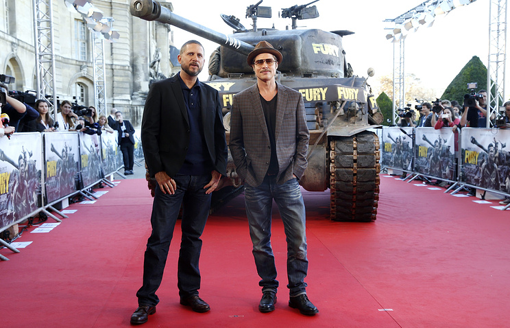 US director David Ayer (L) and actor Brad Pitt (R) at Fury premiere in Paris on 18 October