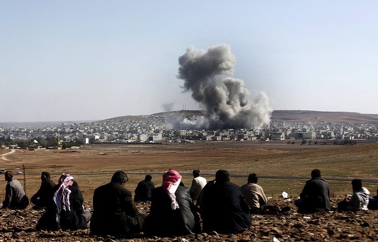 Explosion after an apparent US-led coalition airstrike on Kobane, Syria, 22 October 2014
