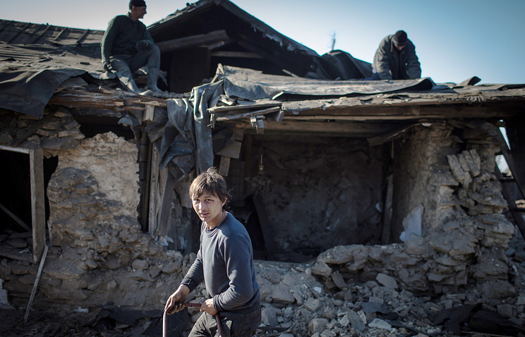 Damaged house in the aftermath of a shelling attack in Luhansk region