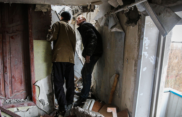 Residents inspect a house in eastern Ukraine's Horlivka after a shelling attack in mid-November