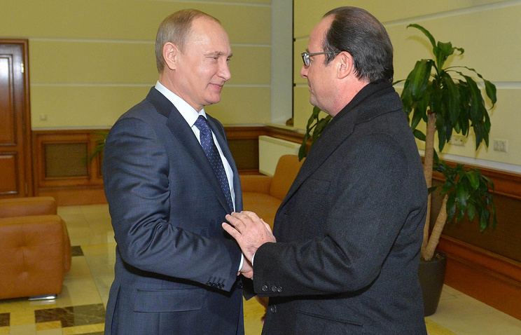 Russian President Vladimir Putin and French President Francois Hollande