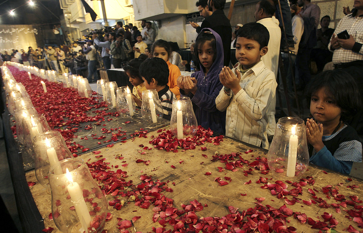 Candle light vigil for the victims of a Taliban attack on a school in Peshawar