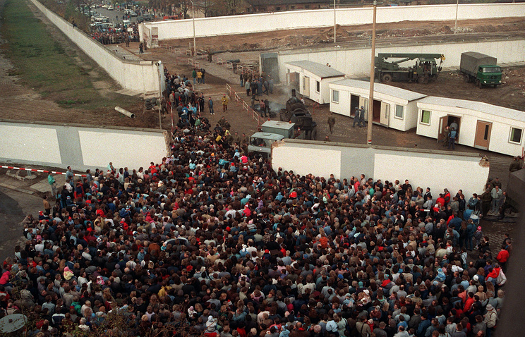 East Berlin residents waiting to cross into the West Berlin at the new border crossing after the fall of the Berlin Wall, Germany, 1989